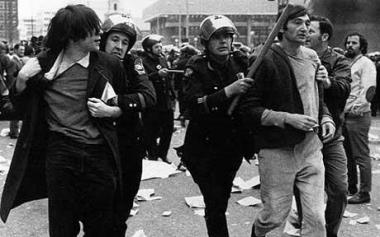 Howard Zinn. Zinn, right, being arrested at an anti-Vietnam war demonstration in the 1960s