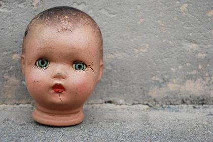 antique_doll_head_against_cement_by_cassiehillis-d68976j_
