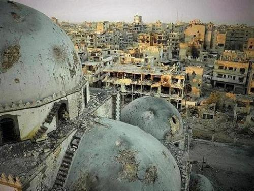 "A handout image released by the Syrian opposition's Shaam News Network on July 25, 2013, allegedly shows the Khaled bin Walid mosque whose mausoleum has been partially destroyed in the al-Khalidiyah neighbourhood of the central Syrian city of Homs. Syrian army shelling destroyed the centuries-old mausoleum a monitoring group and activists said on July 22. Reports of the destruction of the Sunni Muslim pilgrimage site emerged as an intense army campaign to reclaim rebel-held areas of Homs, a strategic junction city, entered its fourth week. AFP PHOTO/HO/SHAAM NEWS NETWORK == RESTRICTED TO EDITORIAL USE - MANDATORY CREDIT ""AFP PHOTO / HO / SHAAM NEWS NETWORK"" - NO MARKETING NO ADVERTISING CAMPAIGNS - DISTRIBUTED AS A SERVICE TO CLIENTS - AFP IS USING PICTURES FROM ALTERNATIVE SOURCES AS IT WAS NOT AUTHORISED TO COVER THIS EVENT, THEREFORE IT IS NOT RESPONSIBLE FOR ANY DIGITAL ALTERATIONS TO THE PICTURE'S EDITORIAL CONTENT, DATE AND LOCATION WHICH CANNOT BE INDEPENDENTLY VERIFIED ==-/AFP/Getty Images"