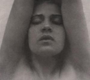 Tina_Modotti_with_her_arms_raised_-_Edward_Weston_restoration